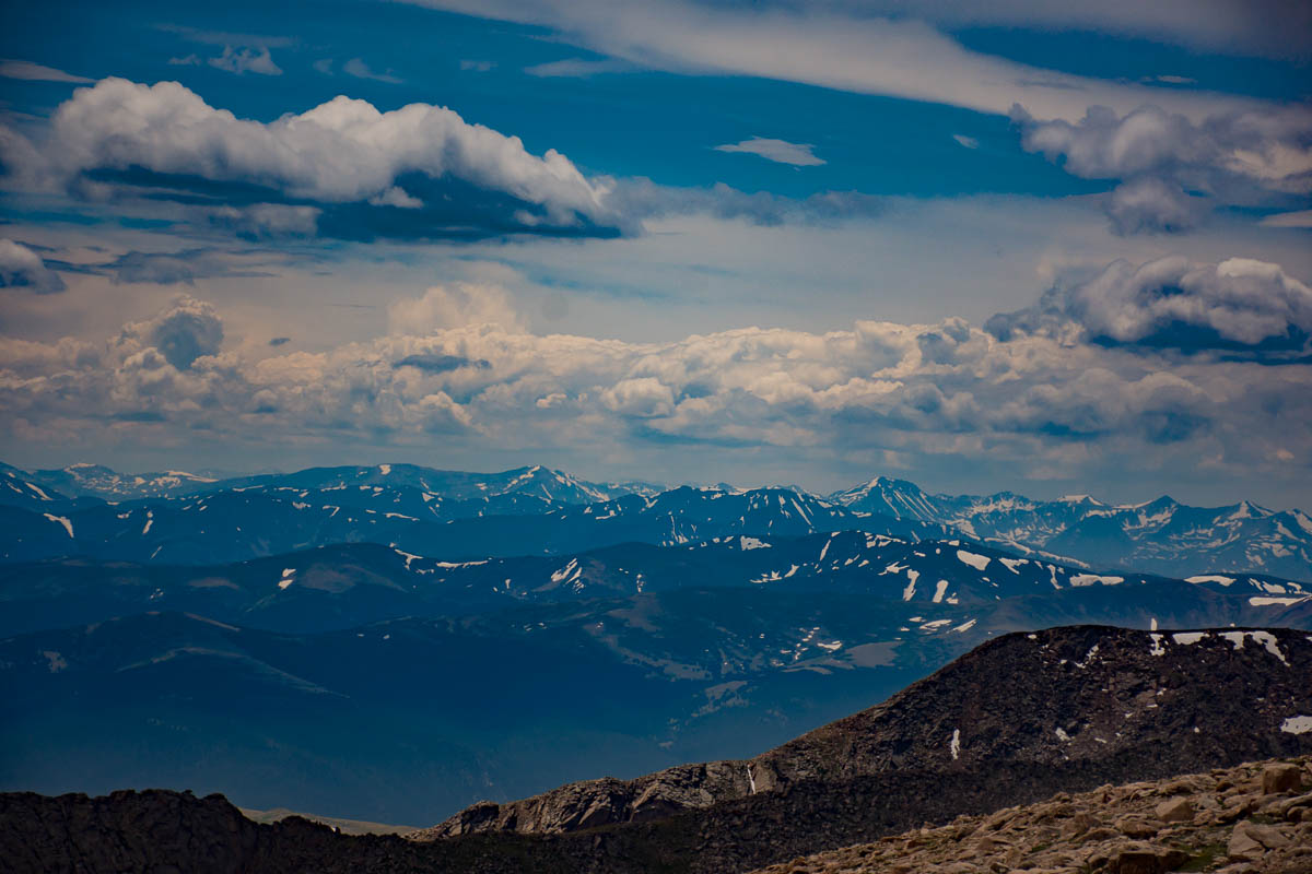 More snow capped Rockies seen from the top of Mt. Evans.
