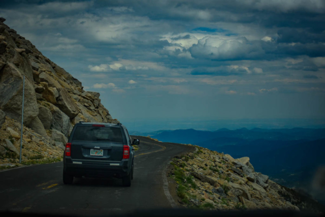 The road up to Mt. Evans is a winding, steep, narrow, white knuckle drive.