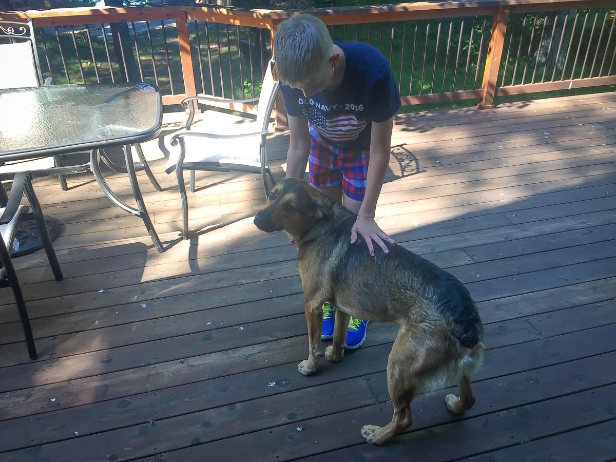 Kai with Remmington on the deck