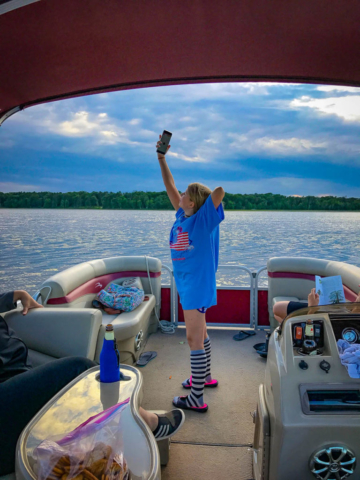 Nora taking selfies on the boat.