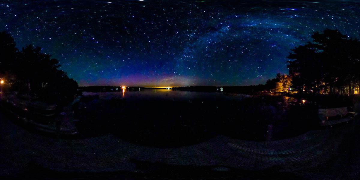 Milky way panorama over Bass Lake
