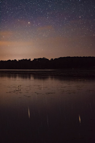 Stars relfected on gentle waves in Bass Lake